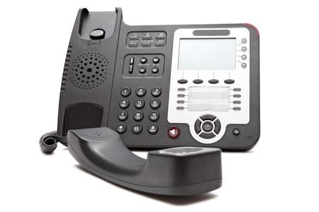 Black IP phone close up isolated on white background closeup