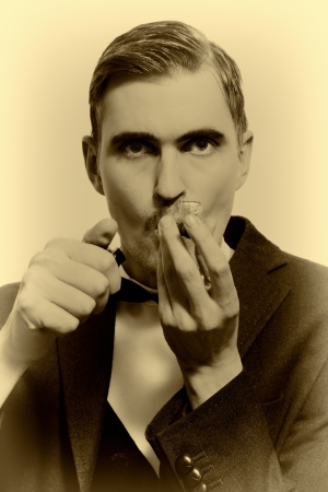 retro portrait of adult man smoking pipe closeup photo