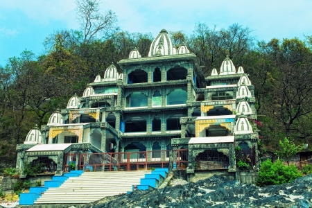 ashram: Indian ashram on the background of mountains and forests Stock Photo