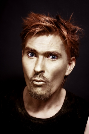 young attractive blue-eyed men with gold makeup and red hair photo