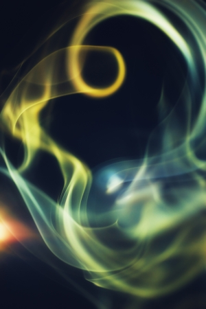 Abstract colorful smoke on a black background photo