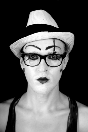 Mime in white hat and glasses photo