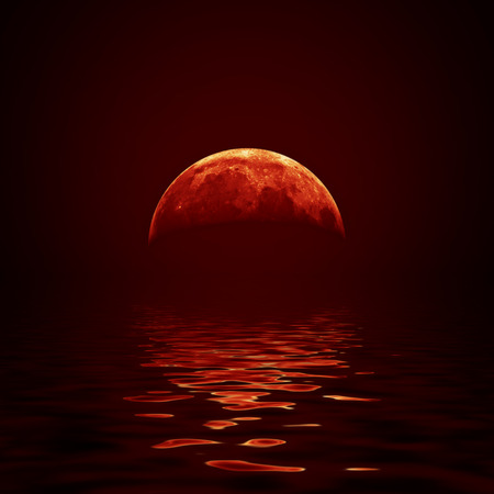 moonlight: Red moon reflected in a wavy water surface