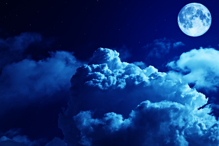 Tragic night sky with a full moon and shining stars photo