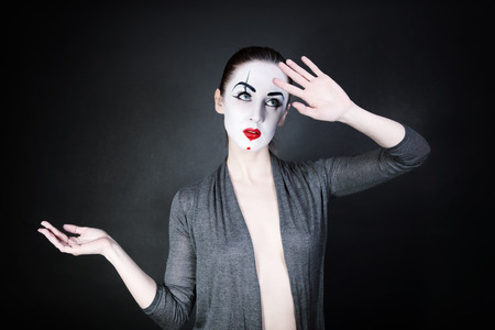 Portrait of a dancing woman mime on a black background photo