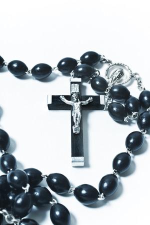 personal god: Catholic rosary with crucifix on white background