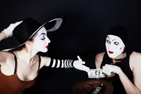 Portrait of two mimes on a black background photo