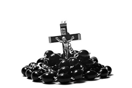 personal god: Catholic rosary with a crucifix isolated on white background closeup