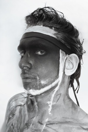treacherous: Portrait of man with black theatrical makeup on white background