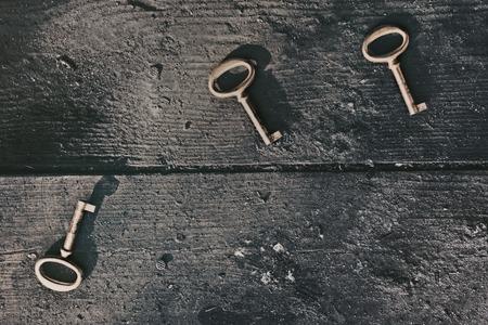 floorboards: Old lost keys on floorboards closeup
