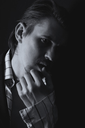 penumbra: Black and white portrait of a young man on a black background