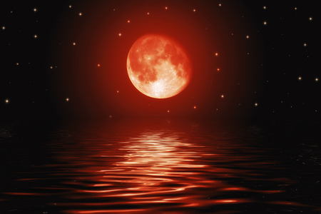 Big bloody red moon and stars reflected in a wavy water surface Stok Fotoğraf