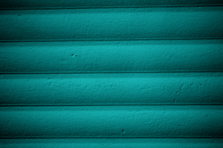 background color: Texture of wooden wall painted with blue paint