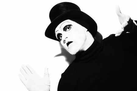tophat: Portrait of a gloomy theater mime wearing a black top-hat