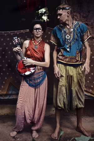 performers: Full-length portrait of two street performers