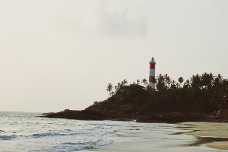 kovalam: Lighthouse on rocky shore. Kovalam , Kerala, India