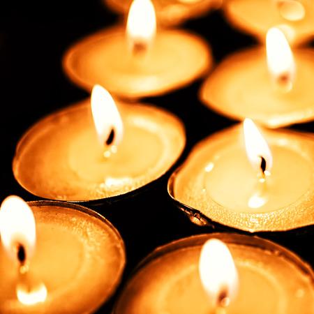 tea candles: Tea candles burning in the darkness closeup Stock Photo