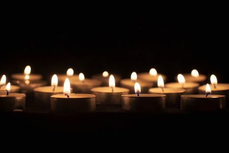 tea candles: Group of tea candles on a black background