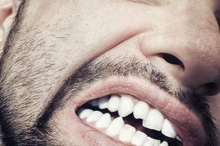 bared teeth: Male mouth with bared teeth close-up