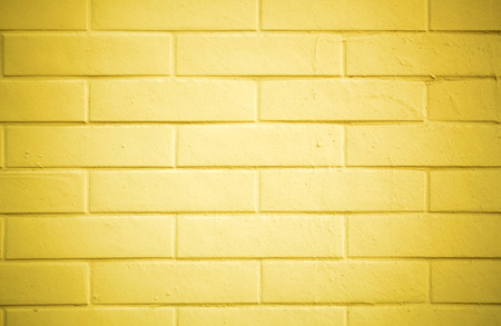 yellow paint: Texture of a brick wall painted with yellow paint Stock Photo