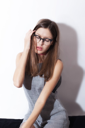 color model: Studio portrait of a beautiful young girl wearing eyeglasses