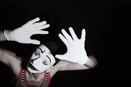 mime: Face of sad mime actor with  stage makeup