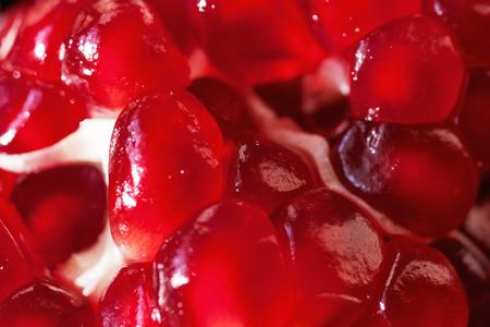 pomegranat: Ripe red pomegranate seeds closeup Stock Photo