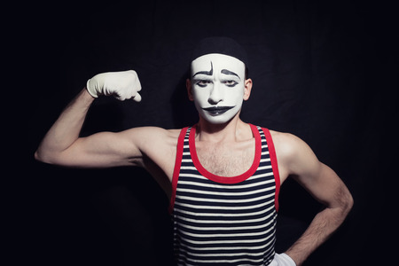 mime: Portrait of mime actor on black background
