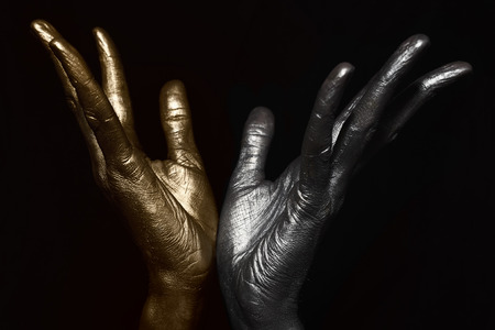 black hands: Male hands with metallic make-up on black background Stock Photo