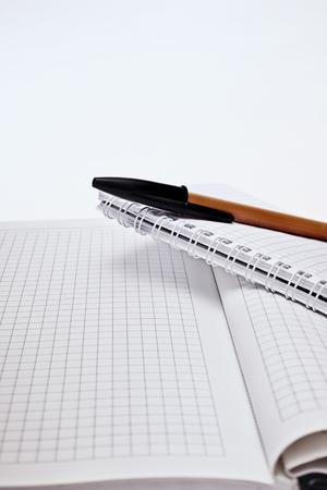 ballpen: Yellow ballpen and two notebook closeup
