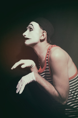 stalking: Portrait of stalking actor mime on a black background Stock Photo