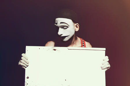 mime: Portrait of mime holding white dirty sheet in hands Stock Photo