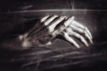 gesticulate: Sculptural Metal male hands on a black background Stock Photo