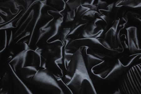 black silk: texture of a black silk close up