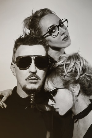 two women and one man: One man and two women wearing sunglasses