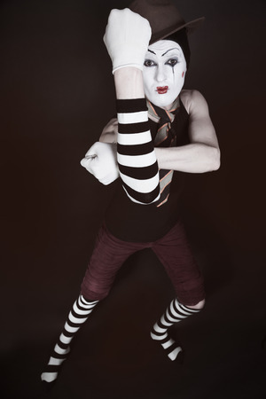 mime: Portrait of theatrical mime on a black background