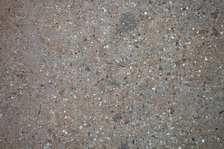 Texture of a dry concrete pavement close-up