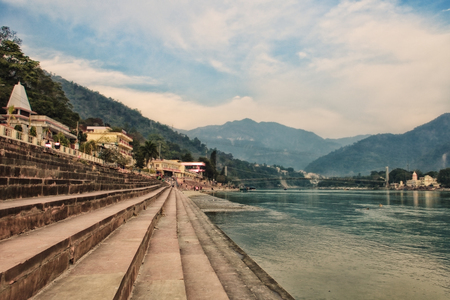 The steps of the ashram at the shore of the sacred river Ganges. India, Rishikesh Stock Photo