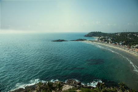 Sandy beach and blue sea view from above. India,  Thiruvananthapuram