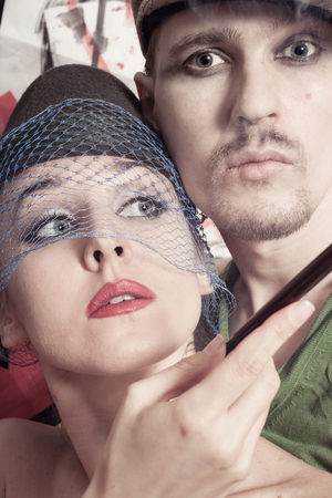 Studio portrait of young man and  woman dressed in retro style photo