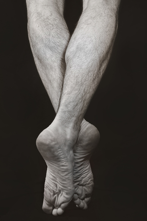 Barefooted male legs standing on tiptoe. Dance Art photo