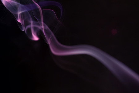 Abstract colorful smoke on a black background Imagens