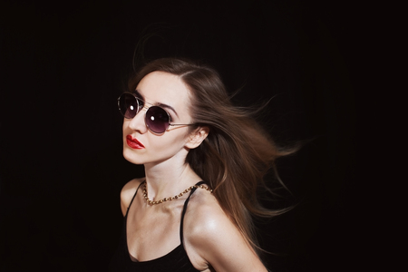 Portrait of a young woman wearing a sunglasses photo