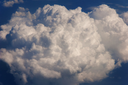 Aerial view from the airplane window to a fluffy cloud. Sky backround Imagens