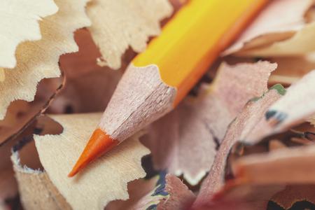 One orange pencil and shavings close-up Imagens