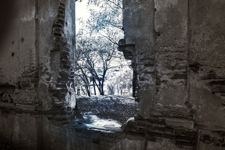 Window in the old ruined abandoned building