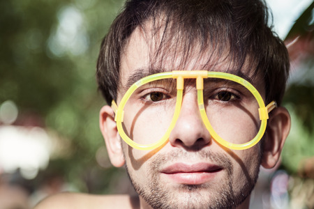 The face of young men wearing a strange glasses Imagens