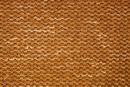 Texture of yellow knitted fabric macro. A tissue sample