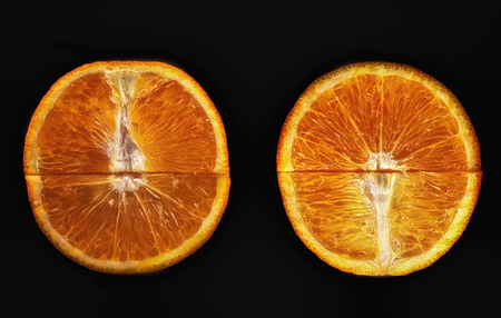 Two halves of an orange on a black background