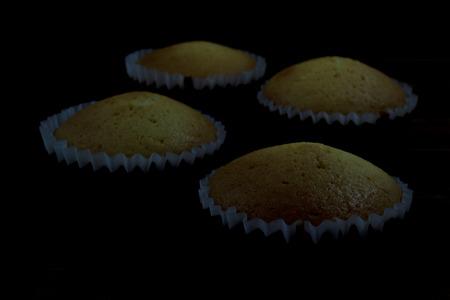 vanilla cupcake: Homemade Vanilla cupcake on black